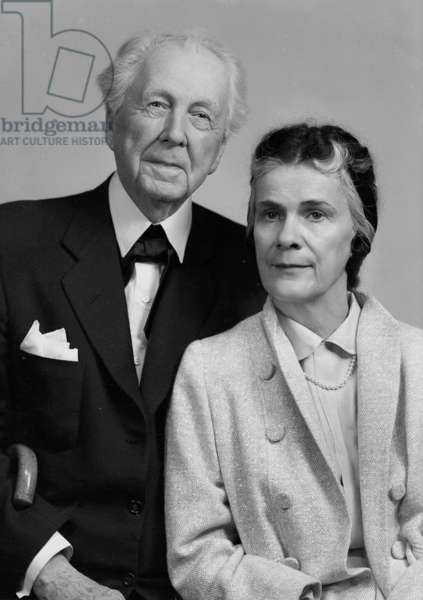 """Unretouched portrait of Mr. and Mrs. Frank Lloyd Wright taken at the same time that each sat individually with Reierson for new passport photos. The photographer's original jacket says """"Retouch couple picture, Mrs. Wright mostly."""" 1956"""