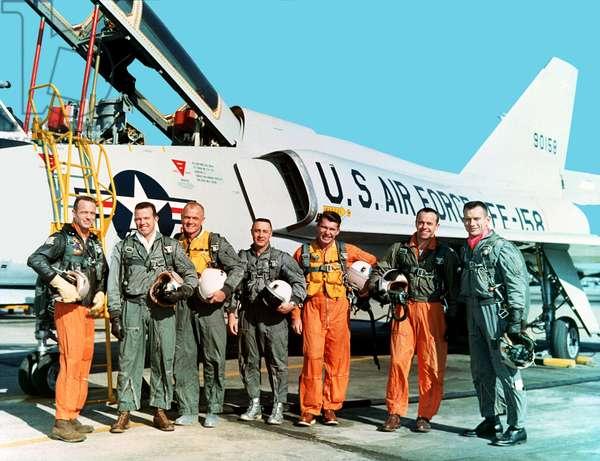 The Original Mercury Seven Astronauts with a U.S. Air Force F-106B jet aircraft. From left to right: M. Scott Carpenter, Leroy Gordon Cooper, John H. Glenn, Jr., Virgil I. Gus Grissom, Jr., Walter M. Wally Schirra, Jr., Alan B. Shepard, Jr., Donald K. Deke Slayton