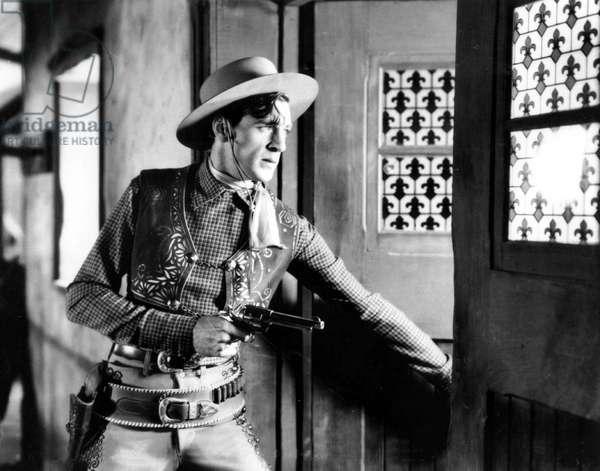 Gary Cooper (1901 - 1961) acteur americain habille en tenue de cowboy