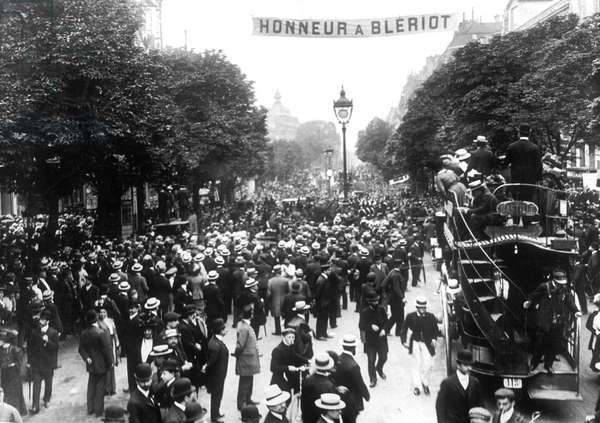 French aviator Louis Bleriot is celebrated in Paris on July 30, 1909 after his crossing of the Channel