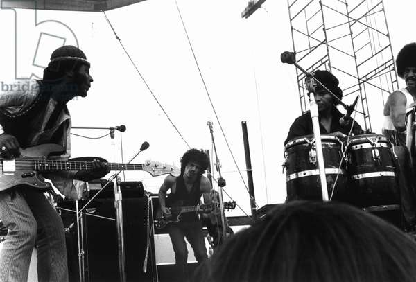 Guitarists David Brown and Carlos Santana during Music and Art Festival in Woodstock, August 1969 (b/w photo)