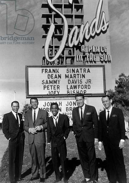 Frank Sinatra, Dean Martin, Sammy Davis Jr, Peter Lawford, Joey Bishop (The Rat Pack) in front of the sign of the Sands club for promotion of film Ocean's 11 1960