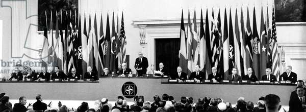 Leaders from fourteen nations listening to English Prime Minister Harold Wilson at the opening of the NATO Conference, London 11 May 1965 (b/w photo)