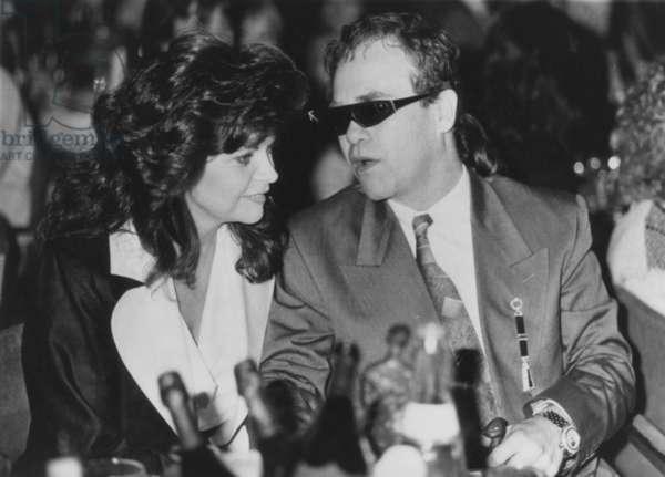 Elton John et Renata, 1986