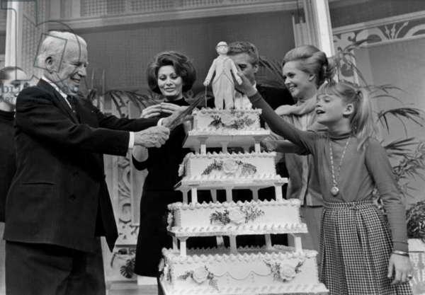 Charlie Chaplin Celebrating his 77Th Birthday Cutting Cake in Presence of Sophia Loren, Tippi Hedren April 16, 1966 (b/w photo)