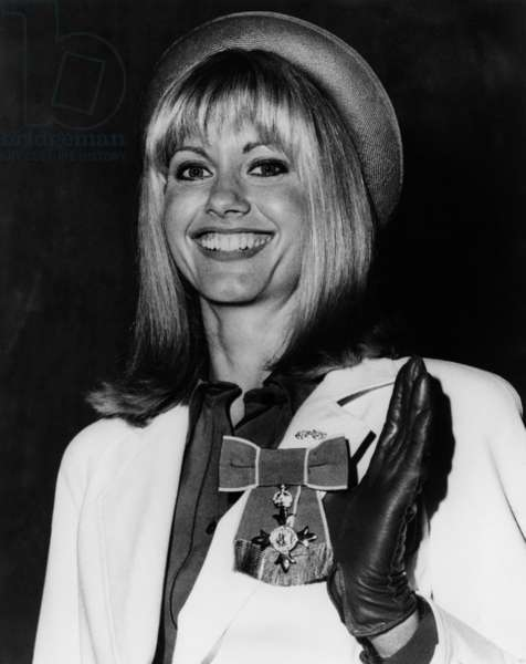Olivia Newton-John (Newton John) With The Order of the British Empire Medal (M.B.E.). March 14, 1979 (b/w photo)