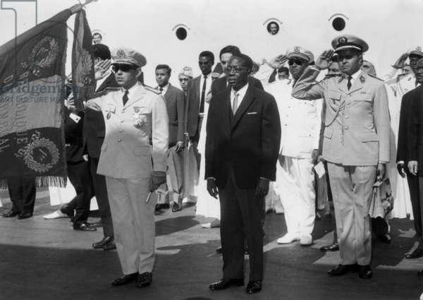 King Hassan Ii of Morocco in Senegal here Arriving in Dakar With Senegalese President Leopold Sedar Senghor March 24, 1964 (b/w photo)