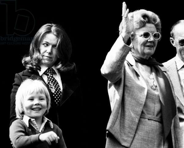 queen Juliana of Holland (r) with princess Christina and prince Willem Alexander (son of princess-Beatrix) during parade for the queen's birthday  may 01, 1972 (photo)