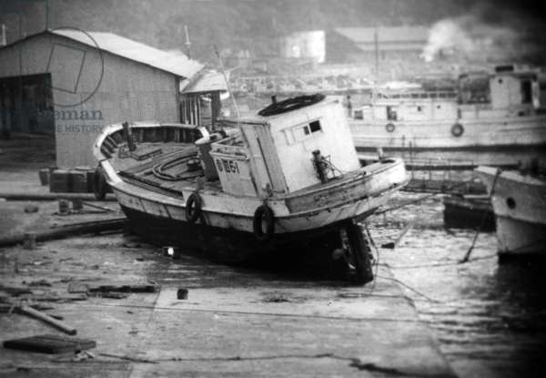 The Boats and the Remains of The Small Port of Peaceful, in Japan, Were Raised and Transported By Vaguenesses of The Tsunami (Consequences of The Seism and the Earthquake in Chile) Inside The City in The Middle of The Houses, Photographed on May 28Th, 1960 (b/w photo)