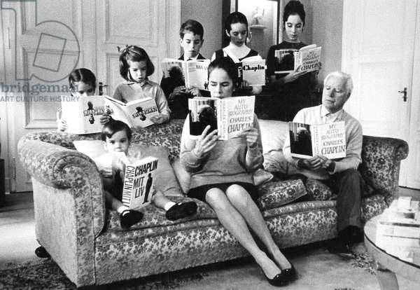 Charlie Chaplin with his wife Oona and their children in Switzerland, 1965,  seated James-Christopher (3) and standing l-r Annette-Emilie (6) Jane (8) Eugene (12) Victoria (14) Josephine (16) (b/w photo)