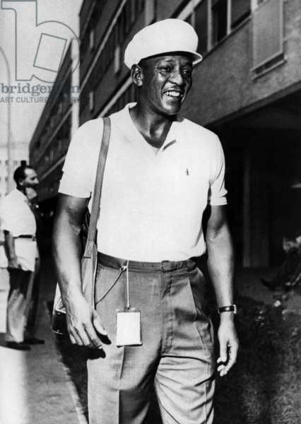 Jesse Owens, the former Olympic Champion, here in 1960 at the Olympic Games in Rome where he attended as a spectator. (b/w photo)