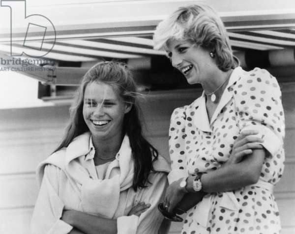In Windsor, Princess Of Wales Diana (Diana Spencer, Lady Di) attends a Polo Match Displayed By Her Husband Prince Charles. The Princess Wars Her Husband's Watch And Siena. With Lady Sarah A Her Odds. July 26, 1983 (b/w photo)