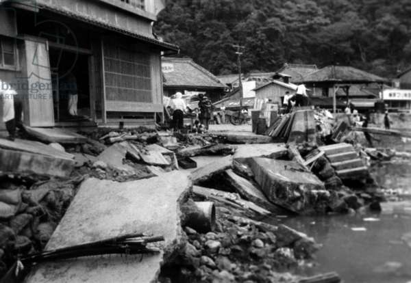 The Population of A Village Devasted By The Tsunami (Following The Earthquakes in Chile) Which Fell Down on Japan, Seek What Can Be Recovered Remains, May 28, 1960  (b/w photo)