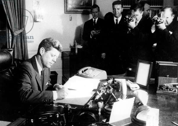 US President John Fitzgerald Kennedy Signing Declaration of Naval Blockade of Cuba, October 29, 1962  (b/w photo)