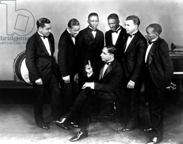 "Pianist Jelly Roll Morton (Setaed) and Jazz Band The Red Hot Peppers With (L-R) : Omar Simeon, Andrew Hilaire, John Lindsay, Johnny Saint Cyr, Edward ""Kid"" Hory and George Mitchell, 20-30'S (b/w photo)"