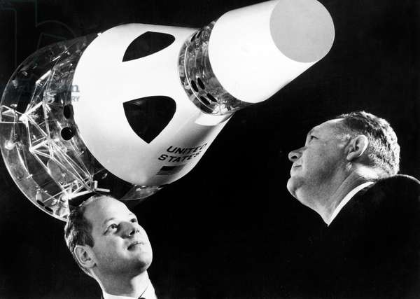 S.J. Domokos, Chief Engineer (L) and J.M. Cummings General Manager of Space Engine Project Operation in Front of Gemeni Space Capsule Scale Model 1965 (Gemini Project) (b/w photo)