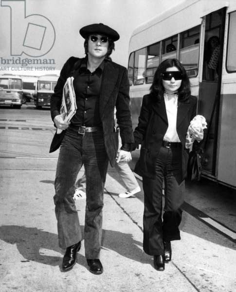 John Lennon and Yoko Ono Arriving in New York For Publication of Book Grapefruit on July 14, 1971 (b/w photo)