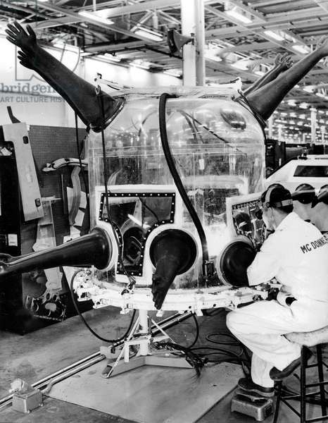 Vacuum Machine (Sterile Environment) Conceived To Weld Components of The Gemini Space Capsule, Manipulated By Engineers of Mc Donnell,1965 (b/w photo)