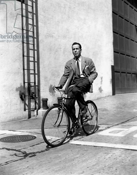 American Actor Humphrey Bogart on A Bicycle, C. 1945 (b/w photo)