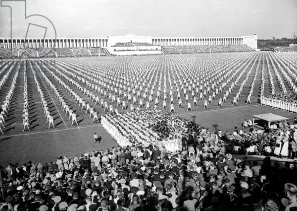"""Hitlerjugend in A Mass Demonstration Featuring The """"Day of Community"""" in Front of Adolfhitler during The Nuremberg Party Rally September 08, 1938 (b/w photo)"""