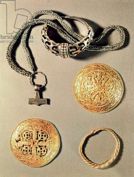 Viking jewellery TtoB LtoR: silver ring and silver necklace bearing a pendant in the form of Thor's hammer; gold brooch; twisted gold ring; gold brooch