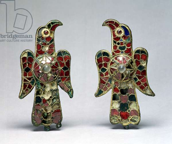 Two eagle-shaped fibulae, discovered in a Cemetery in the Province of Badajoz, Spain, 6th century (gilt bronze, garnets and rock crystal)