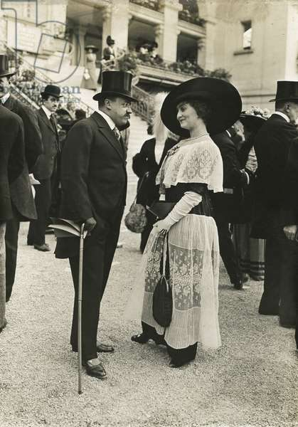 Man and woman in formal attire (b/w photo)