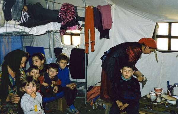 A Chechen Family in a Tent at the 'Sputnik' Refugee Settlement in Ingushetia, November 1999.