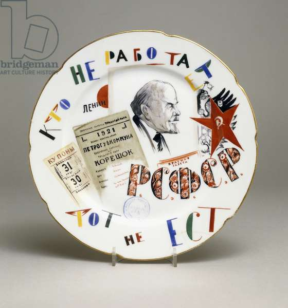 A Soviet propaganda plate, painted with the profile of Lenin and the slogan 'He who does not work does not eat', 1922 (porcelain)