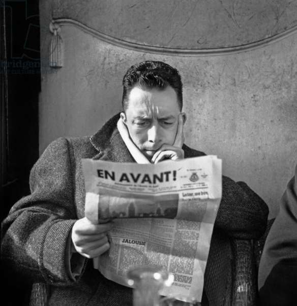 Albert Camus (1913-1960) french writer here reading