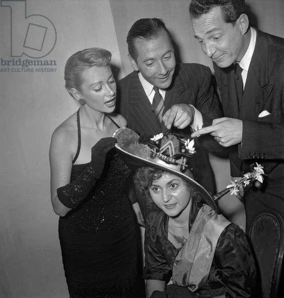 Pierrette Linhard, queen of the Catherinettes, with Martine Carole, Daniel Clerice, Steve Crane, Paris, November 1949 (b/w photo)