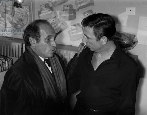 Leo Ferre congratulating Yves Montand after his show in Paris, 13 November 1962 (photo)