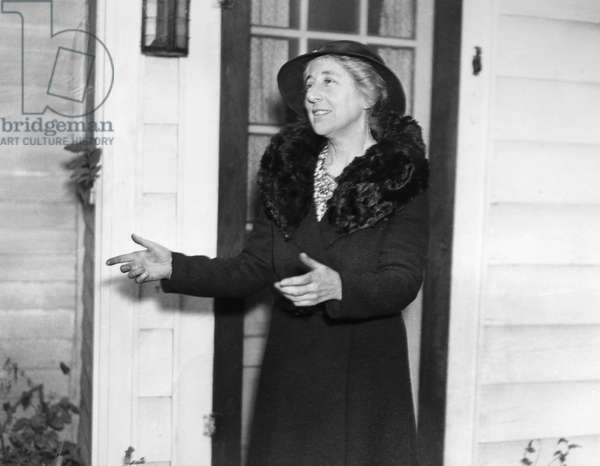 JEANNETTE RANKIN (1880-1973). American suffragist, pacifist, and legislator. Photographed in December 1934, responding to questions about American Legion protests against her appointment as Chair of Peace at Brenau College in Gainesville, Georgia.