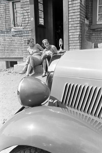 Young women on a trip with a convertible on the hill Brend in the Black Forest, Germany 1930s (b/w photo)