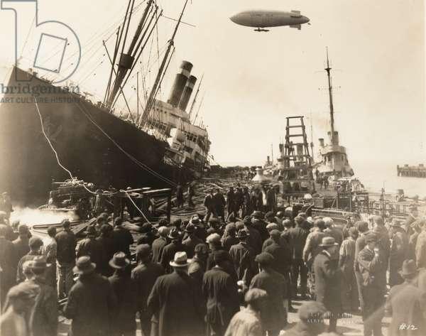 SS America burning at Pier 5, 1926 (b/w photo)
