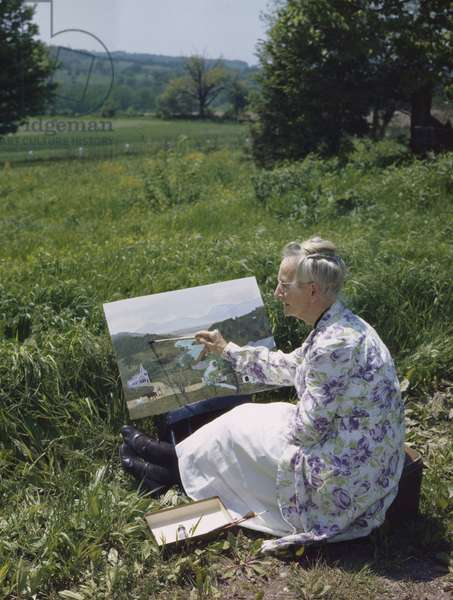 Grandma Moses Painting in the Garden, 1946 (photo)