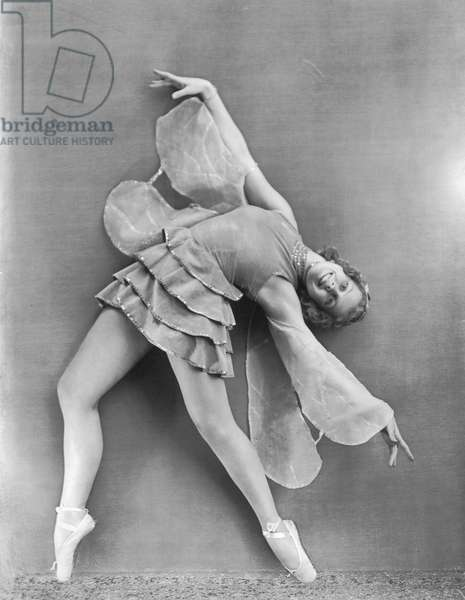 The ballet dancer Alba Wiegele shown dancing. Her costume and pose are reminiscent of a butterfly (b/w photo)