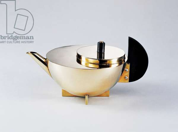 Silver-plated brass hemispherical teapot with ebony handle and cross-shaped base, ca 1934, designed by Marianne Brandt (1893-1983). 20th century.