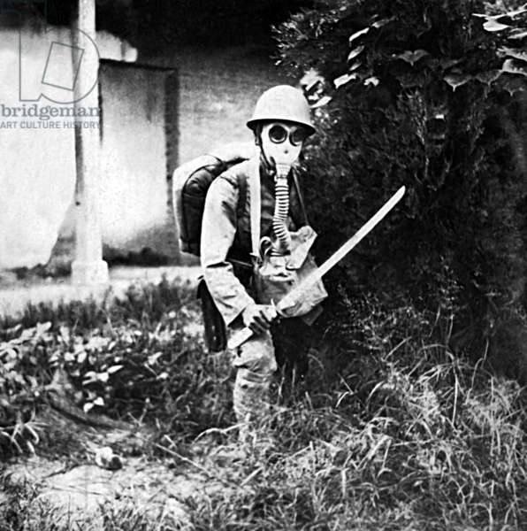 China: Imperial Japanese soldier posing with samurai sword and gas mask, Shanghai, 1937