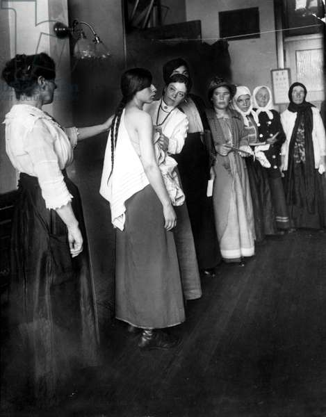 Women immigrants undergoing a physical examination at Ellis Island, N.Y., about 1910