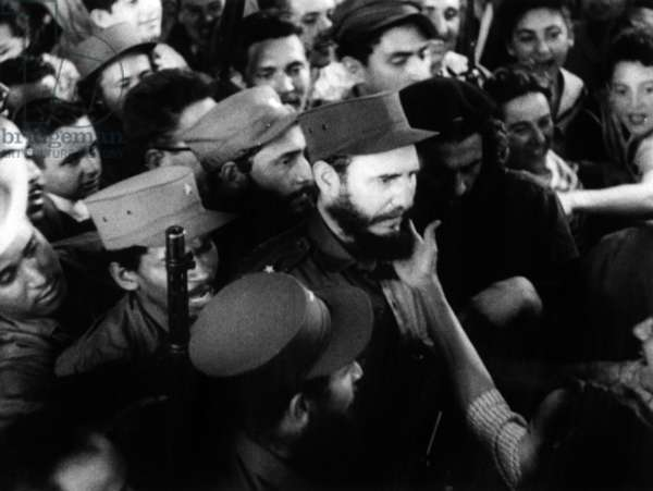 Fidel Castro greeted by the crowd in Cuba in 1959 (on his left is Che Guevara)