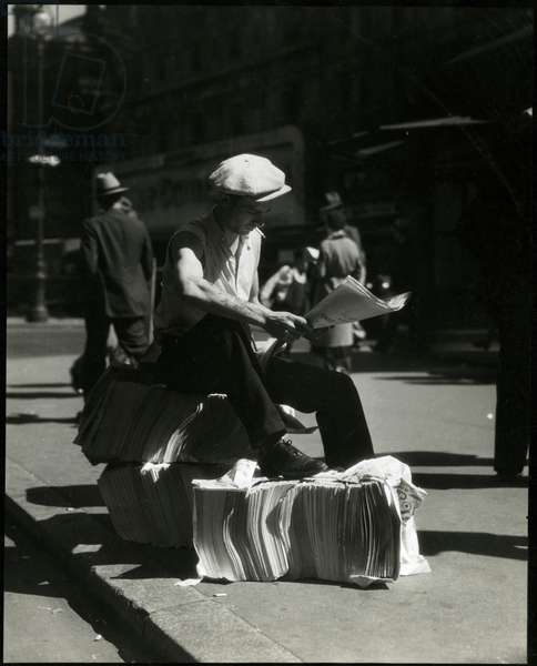 Newspaper vendor, USA, c.1920-38 (gelatin silver photo)