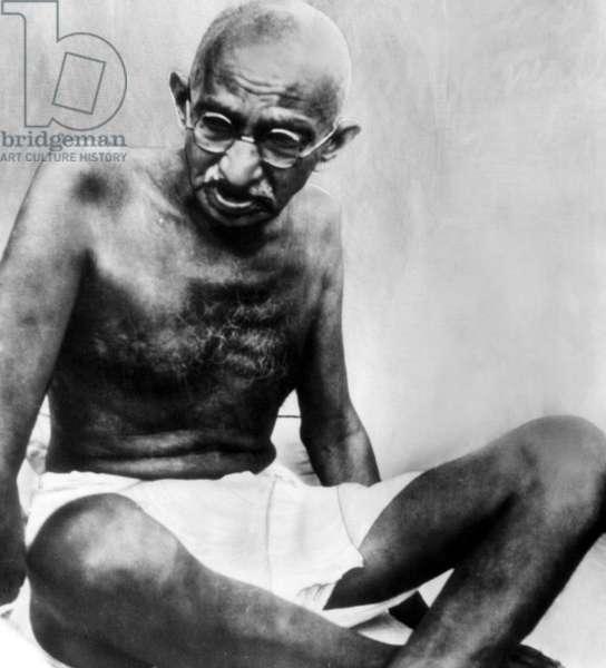 Mahatma Gandhi, 78, pauses during his walking tour. c. October 1947