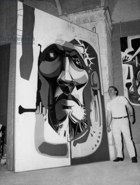 Exhibition Moretti in Nice : here Peinter Raymond Moretti in Front of his Canvas on July 20, 1966 (b/w photo)