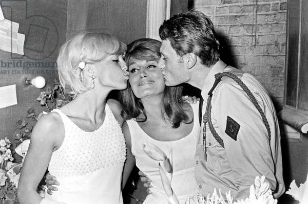 Sylvie Vartan and Johnny Hallyday congratulating Singer Dalida after the Premiere at the Olympia, 3 September 1964 (photo)