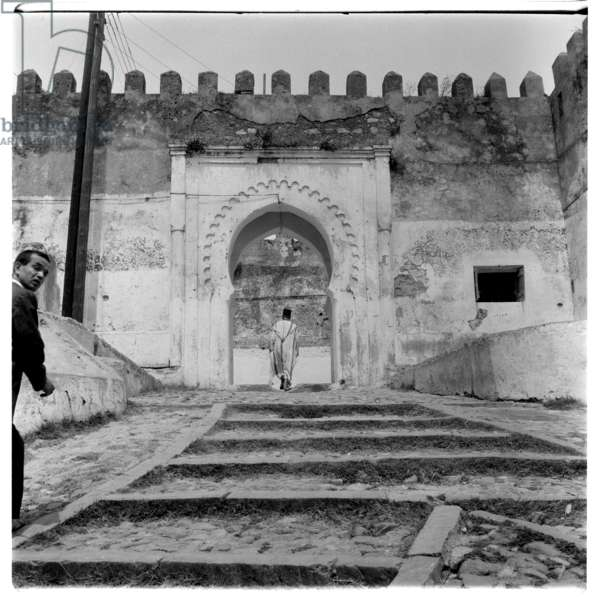 Walking up to a doorway, Tangier, early 1960's (b/w photo)