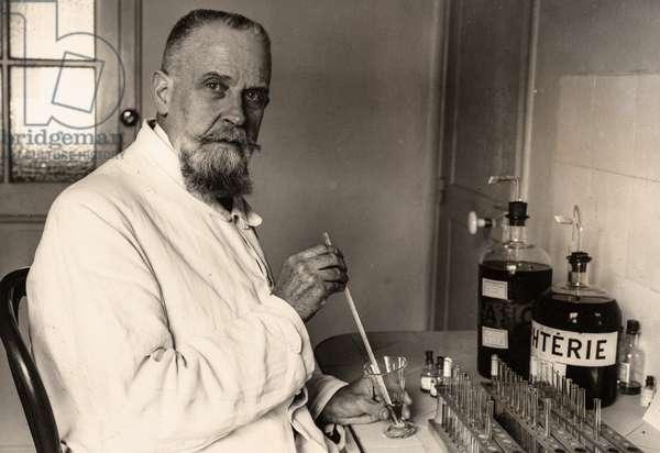 Professor Gaston Ramon with his Diphtheria Vaccine, Institut Pasteur, Paris, France, September 1941 (silver gelatin print)