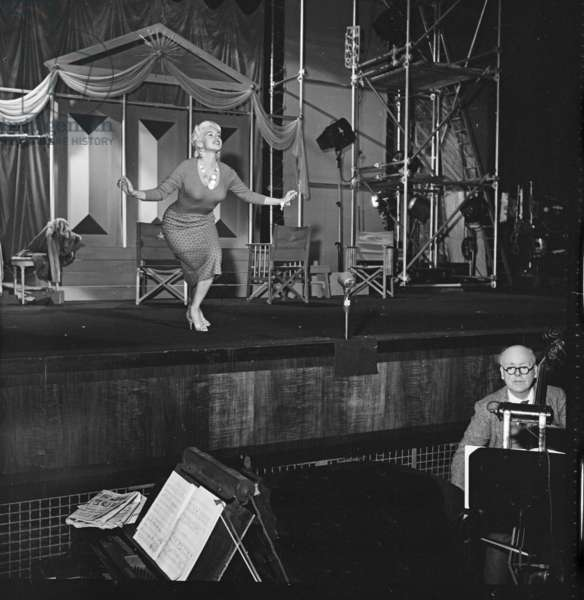 Jayne Mansfield rehearsing her curtsey to the Queen, Royal Film Performance, Granada TV, London, UK, 1958 (b/w photo)