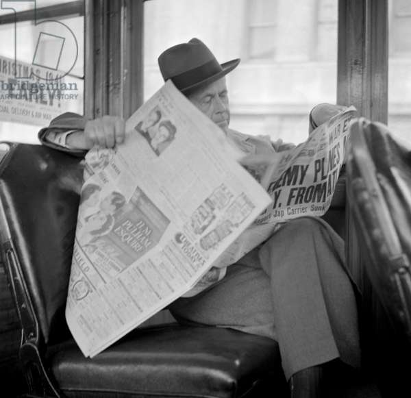 Man Reading Newspaper on Bus, Monday Morning after Japanese Attack on Pearl Harbor, San Francisco, California, USA, December 8, 1941