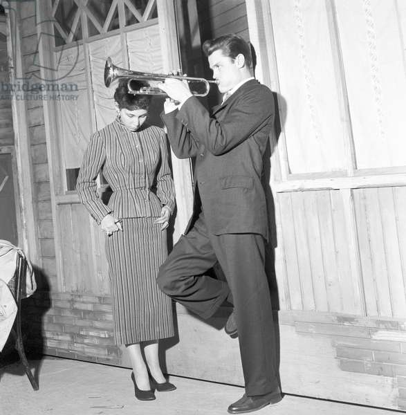 Chet Baker playing (b/w photo)
